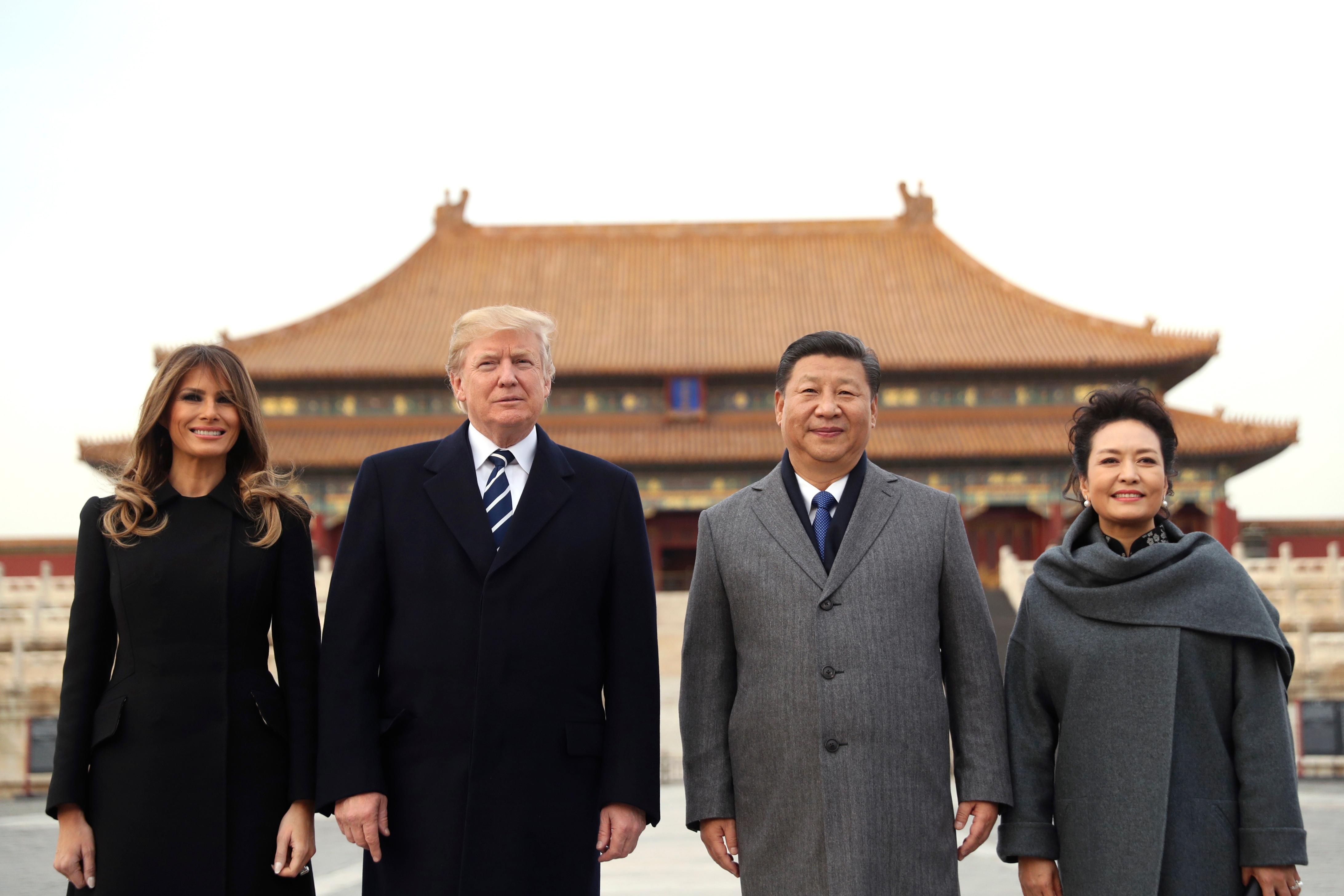 President Donald Trump, second left, first lady Melania Trump, left,  Chinese President Xi Jinping, second right, and his wife Peng Liyuan, right, stand together as they tour the Forbidden City, Wednesday, Nov. 8, 2017, in Beijing, China. Trump is on a five country trip through Asia traveling to Japan, South Korea, China, Vietnam and the Philippines. (AP Photo/Andrew Harnik)