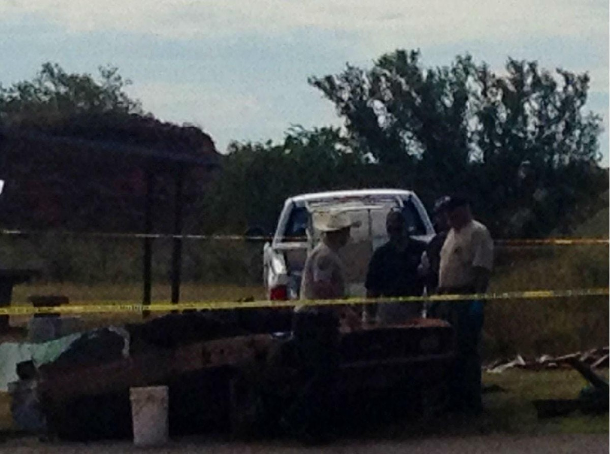 Authorities continue to collect evidence at the scene where the two vehicles were pulled out of the water.