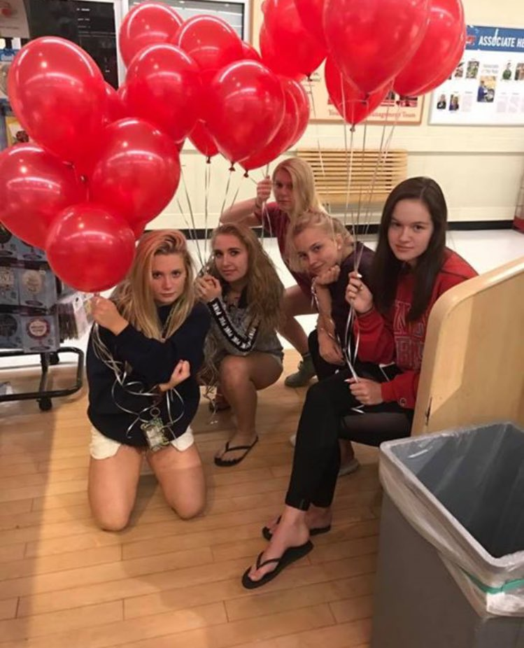 A girl says she and her friends are behind the red balloons found tied to sewer grates in a small Pennsylvania town, not a homicidal clown. (Twitter/@PeytonReiff)