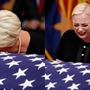 Sen. John McCain's family cries over flag-draped casket at Arizona State Capitol