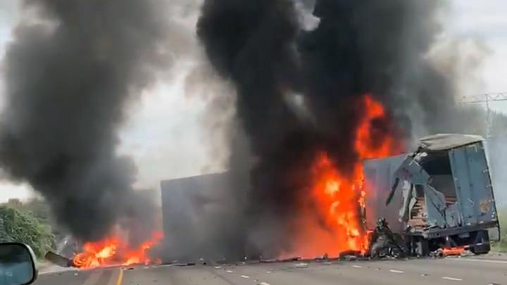 In this still image from video, at least one semi-truck can be seen burning in the southbound lanes of Interstate 5 just north of Woodburn after it was involved in a crash with another semi Tuesday, Oct. 15, 2019. (Photo: Alex Ihnat)