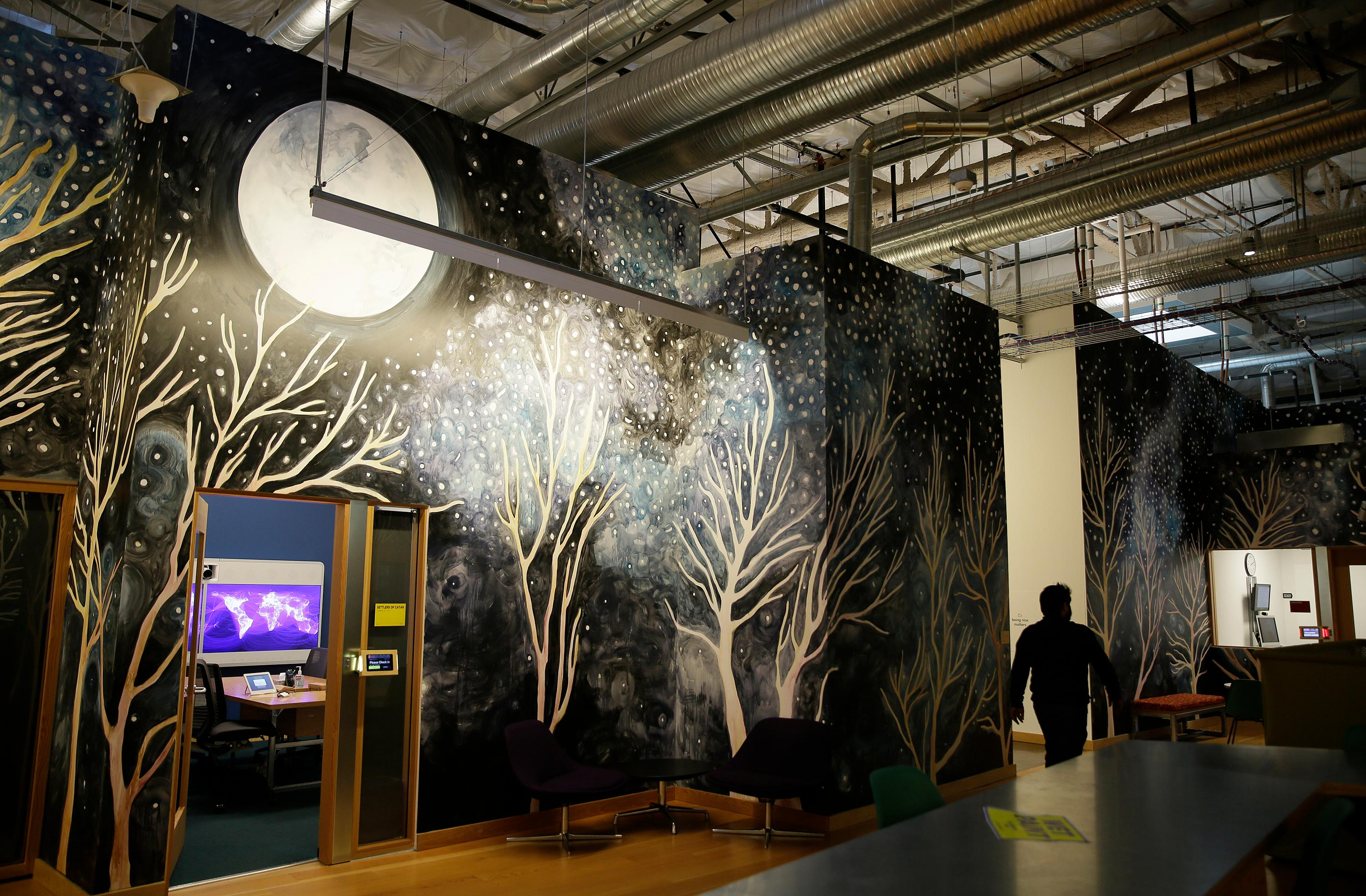 In this photo taken Monday, Dec. 18, 2017, a mural of a tree grove covers a wall inside a campus building at Facebook headquarters in Menlo Park, Calif. Facebook is unveiling a new AI-powered feature just in time for alcohol-filled holiday parties: you can now see untagged pictures of your face on your friend's news feeds and ask the poster to remove them. (AP Photo/Eric Risberg)