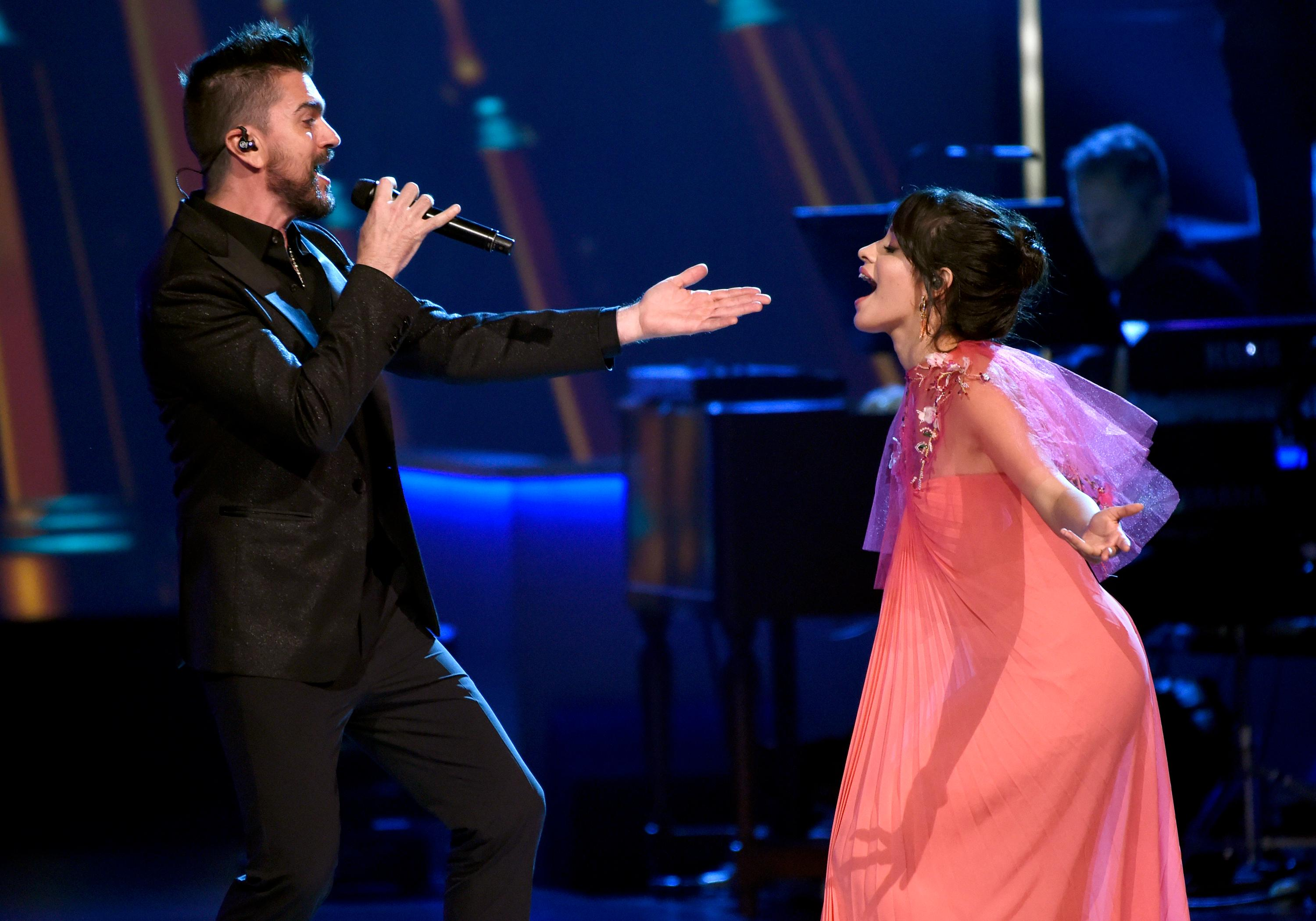 "Juanes, left, and Camila Cabello perform ""Quisiera Ser"" at the Latin Recording Academy Person of the Year tribute honoring Alejandro Sanz at the Mandalay Bay Convention Center on Wednesday, Nov. 15, 2017, in Las Vegas. (Photo by Chris Pizzello/Invision/AP)"
