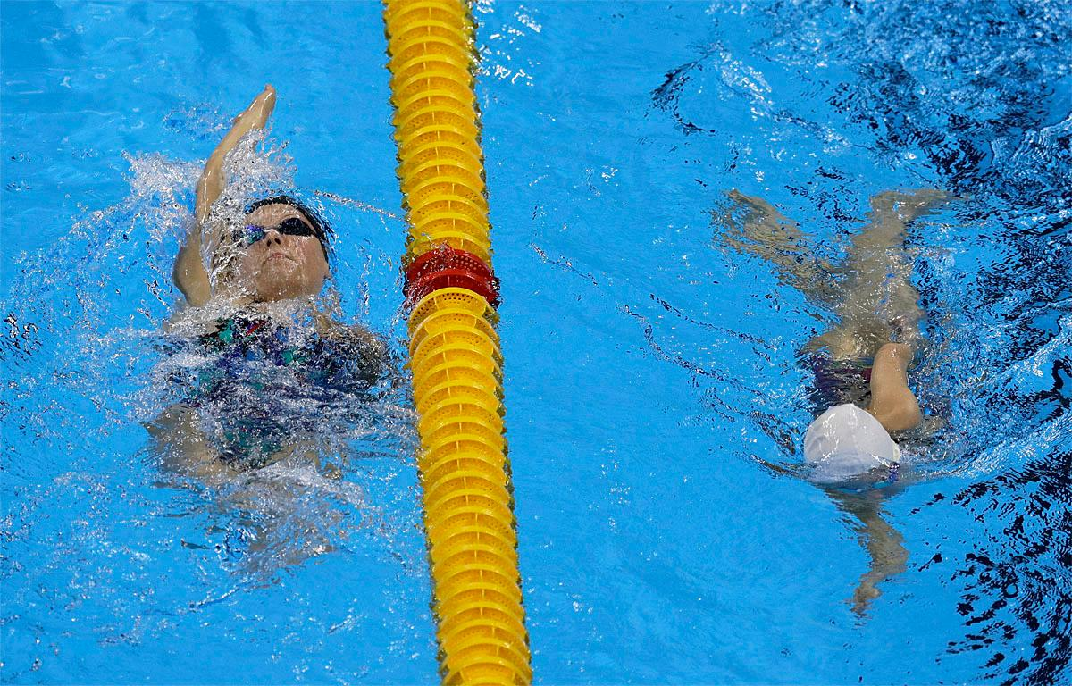 Jessica Long of the U.S. , left, swims during a warm up session before the swimming competitions at the Rio 2016 Paralympic Games in Rio de Janeiro, Brazil, Thursday, Sept. 8, 2016.(AP Photo/Leo Correa)