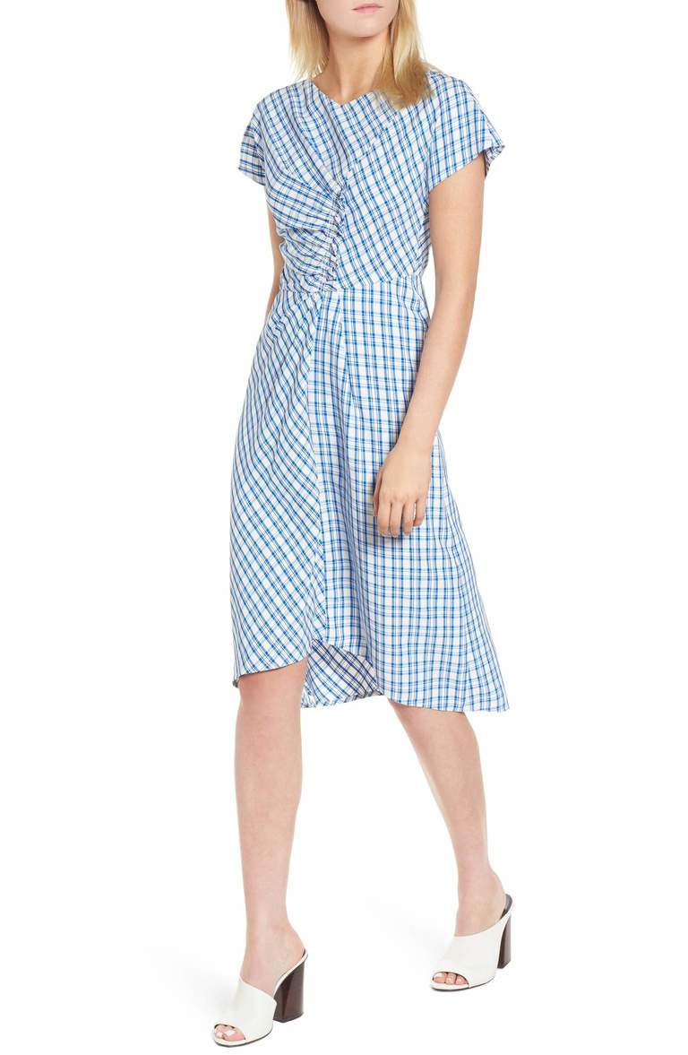 Cleverly shaped with a wrapped and ruched bodice and a twist of front pleats, a dress with ladylike charm features a fresh and summery check-plaid twill. You can wear this to work and for play. Price: $399 at Nordstrom. (Image: Nordstrom){ }