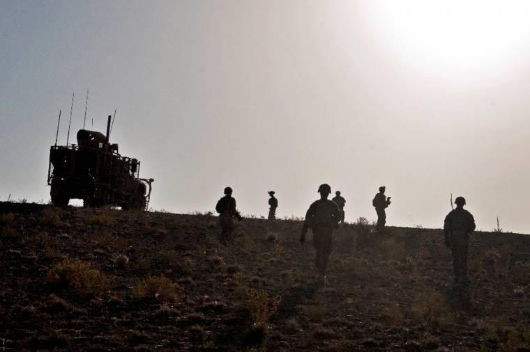 U.S. soldiers climb a hill during a presence patrol near Forward Operating Base Shank in Afghanistan's Logar province, Oct. 8, 2013.