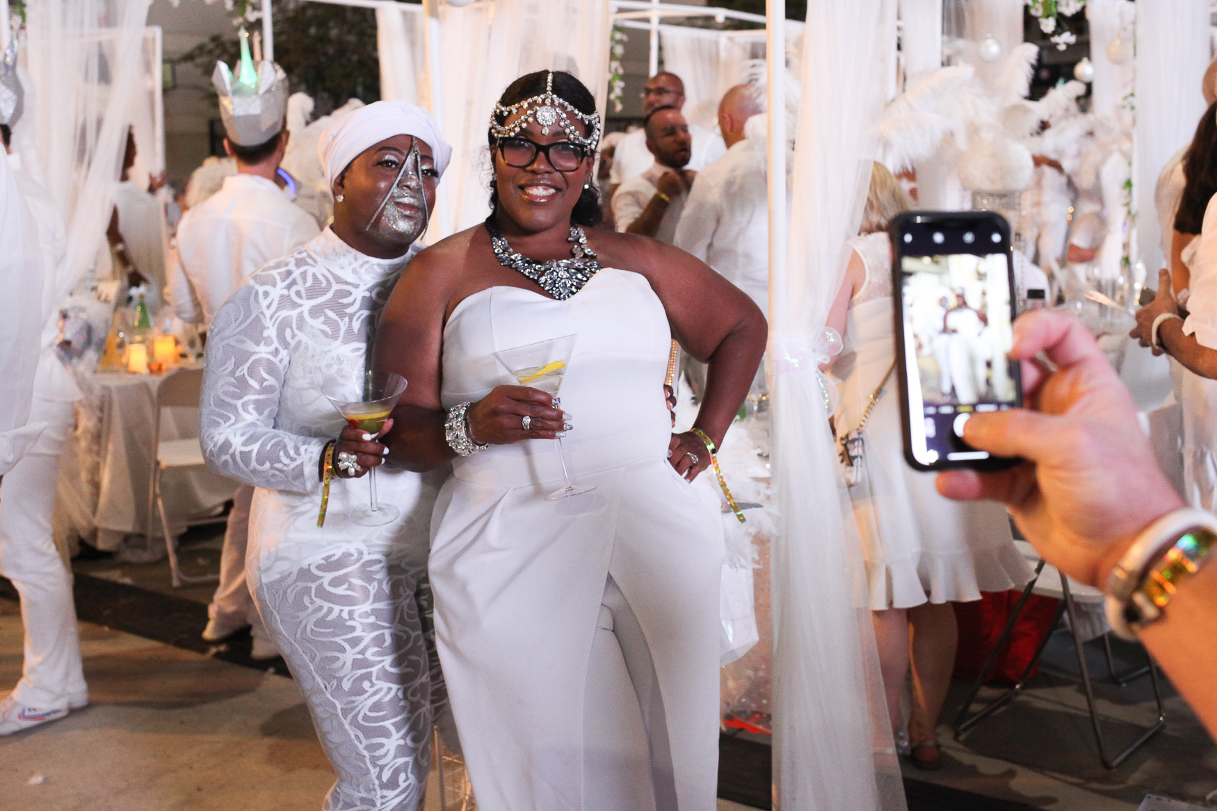 These off-the-wall looks at Diner en Blanc were totally captivating - especially that lace jumpsuit.  (Image: Amanda Andrade-Rhoades/DC Refined)
