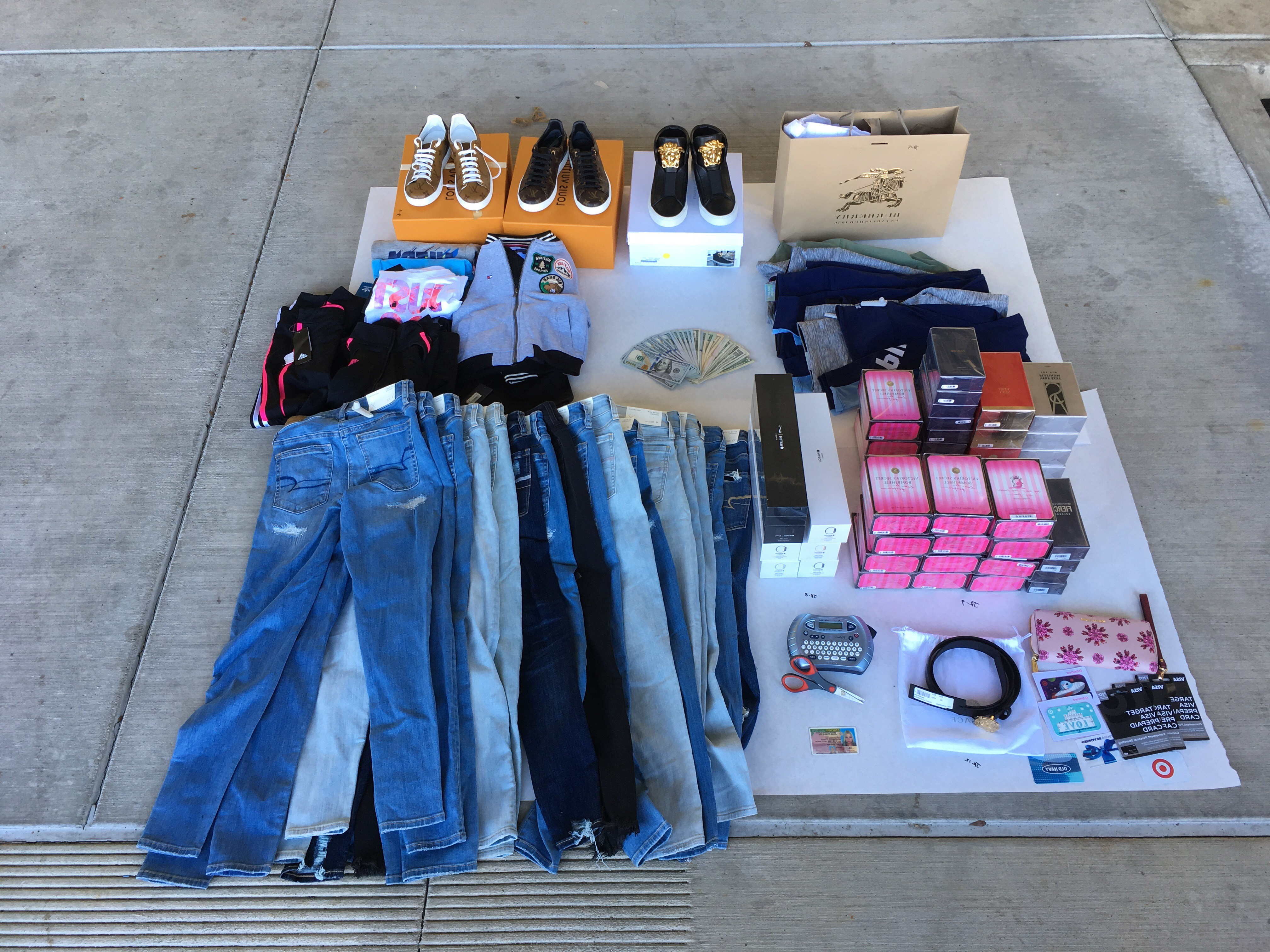 Redding police displays a number of items recovered during an investigation into stolen identity and credit card theft. Camila Fernandez, 25, and Paola Jerez-Huerta, 29, were both arrested on multiple charges. (Photo provided by Redding Police Department)