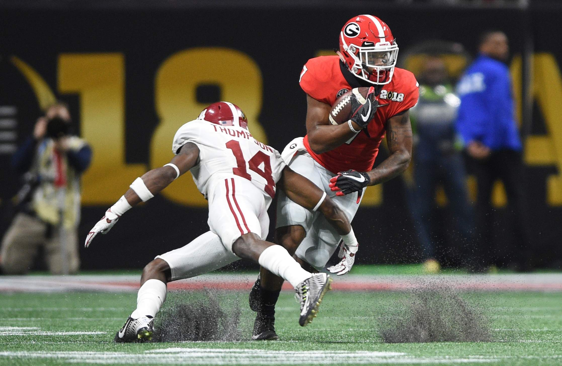 Alabama defender Deionte Thompson tries to get a grip on Georgia's Georgia's D'Andre Swift during the 2018 College Football Playoff National Championship at Mercedes-Benz Stadium in Atlanta, Ga., Monday evening January 8, 2018. MICHAEL HOLAHAN/AUGUSTA CHRONICLE