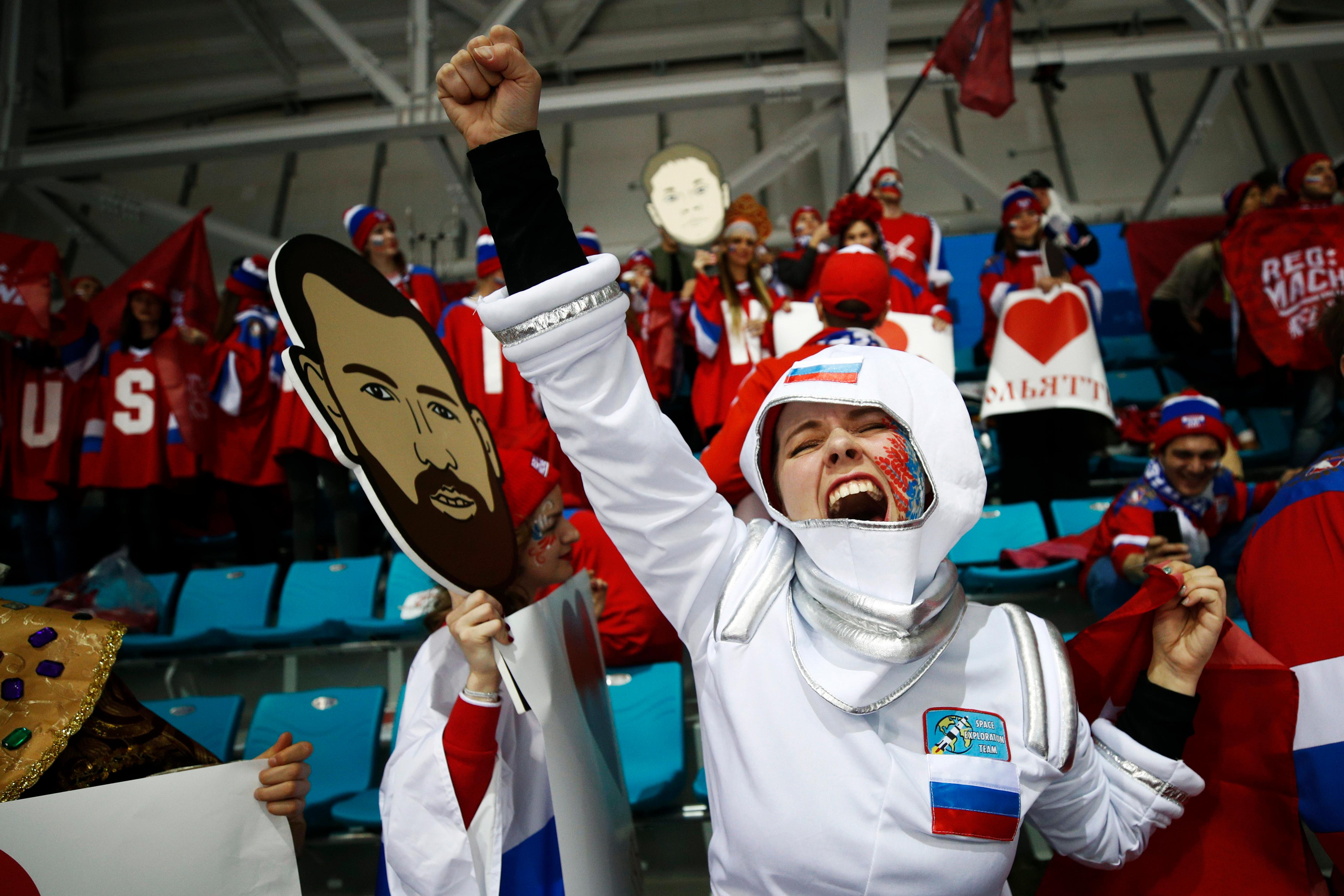 A fan of the Olympic athletes from Russia cheers before the men's gold medal hockey game against Germany at the 2018 Winter Olympics, Sunday, Feb. 25, 2018, in Gangneung, South Korea. (AP Photo/Jae C. Hong)