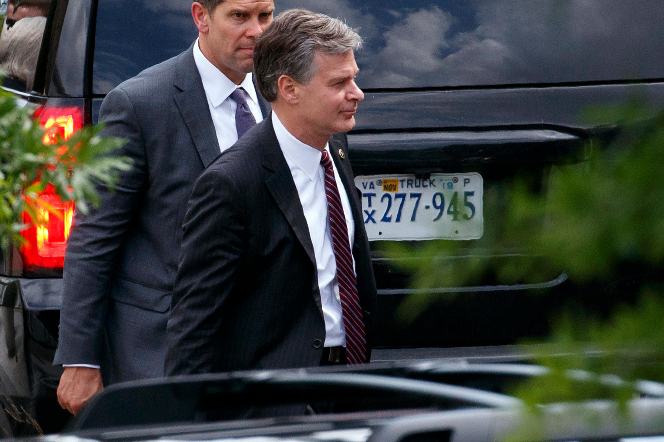 FBI Director Christopher Wray, right, leaves the White House, Monday, May 21, 2018, in Washington. (AP Photo/Evan Vucci)