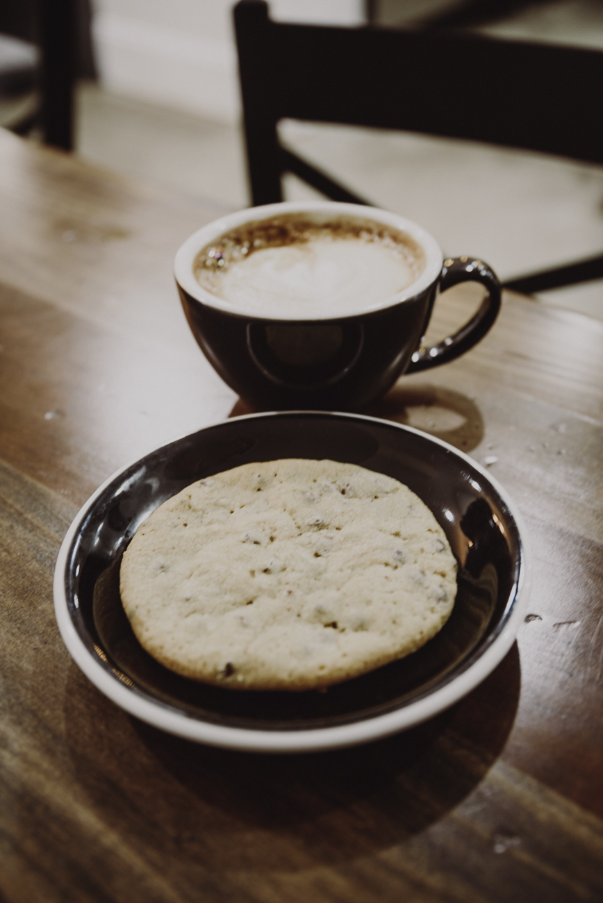 A latte with a chocolate chip cookie{ }/ Image: Brianna Long // Published: 9.12.18