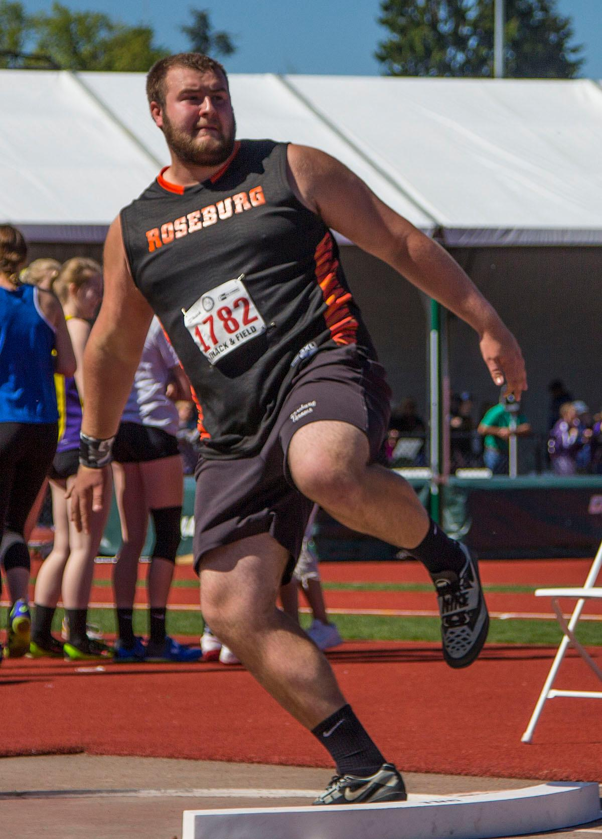 Tyler Sconce from Roseburg High School wins the 6A Boys Shot Put with a distance of 55-09.00 at the OSAA Track and Field State Championships at Hayward Field. Photo by Nichole Louchios, Oregon News Lab.