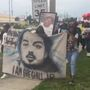 Hundreds march in protest of jury verdict awarding $4 to family of man killed by deputy