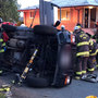 Firefighters rescue woman trapped in West Seattle rollover crash
