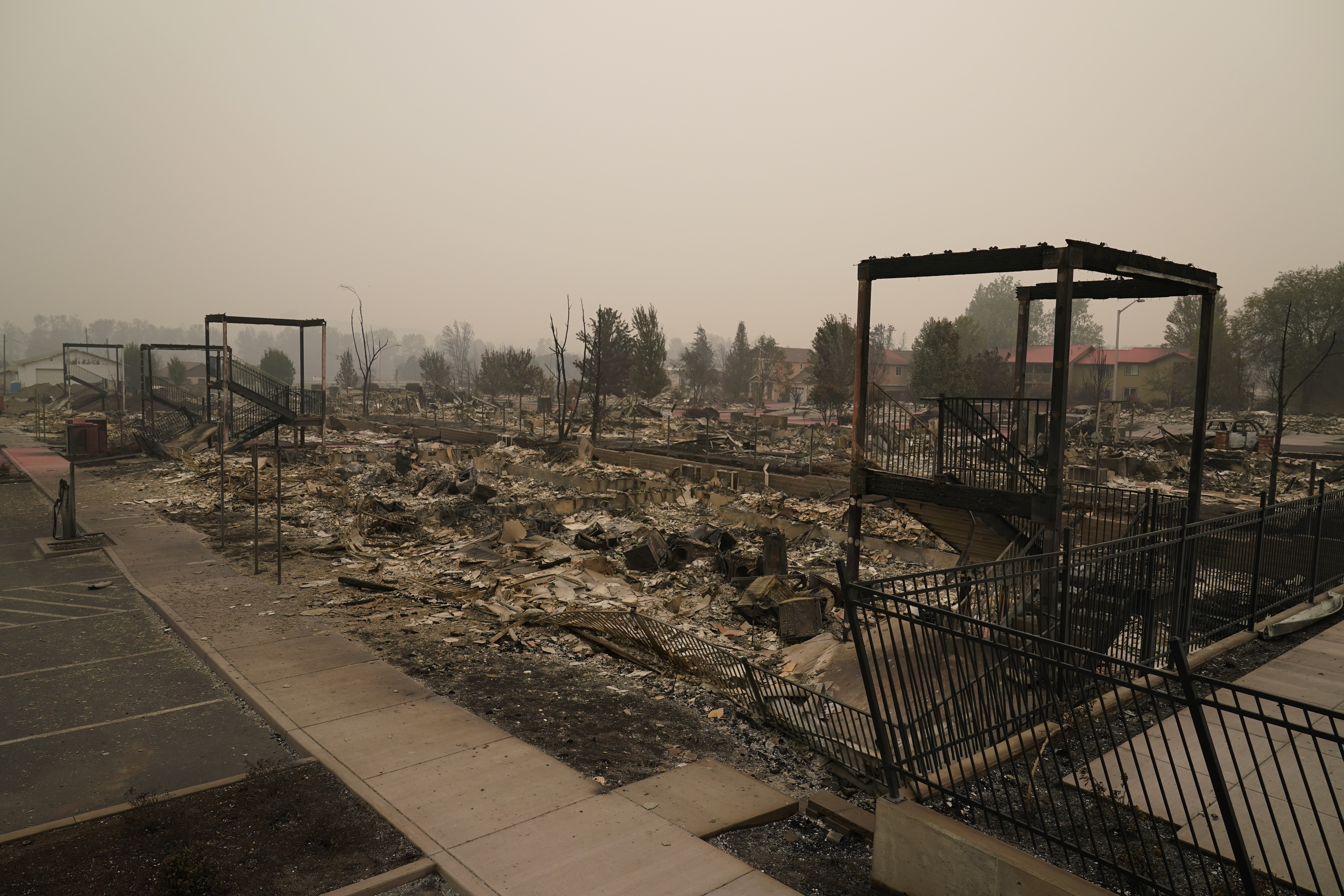 Rubble remains from an area destroyed by the Almeda Fire, Friday, Sept. 11, 2020, in Talent, Ore. (AP Photo/John Locher)