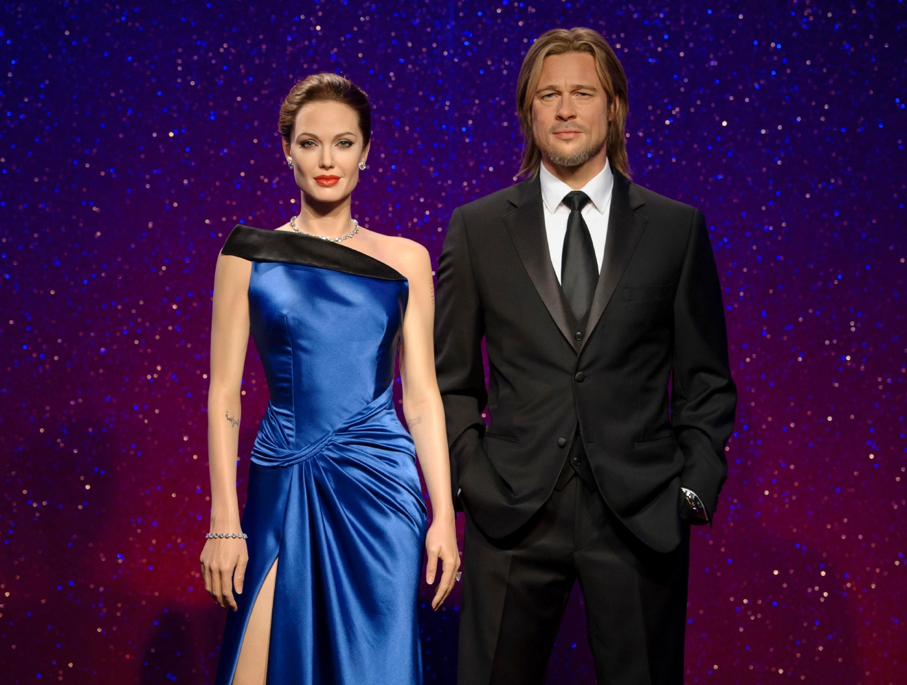 This 2013 photo released by Madame Tussauds shows wax figures resembling married actors Angelina Jolie Pitt, left, and Brad Pitt on display at a Madame Tussauds wax museum. (Madame Tussauds via AP)
