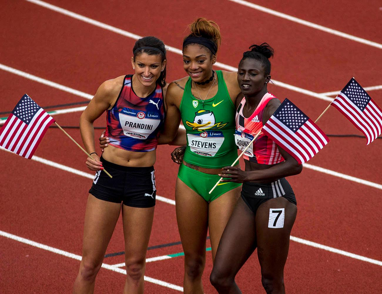 From left to right, Jenna Prandini, Deajah Stevens, and Tori Bowie pose for a photograph after qualifying for the Rio Olympics in the Women�s 200m Dash. Prandini finished third with a time of 22.53. Stevens finished second with a time of 22.30. Bowie finished first with a time of 22.25. Day 10 of the U.S. Track and Field Trials concluded Sunday at Hayward Field in Eugene, Ore. The competition lasted July 1 through July 10. Photo by Amanda Butt