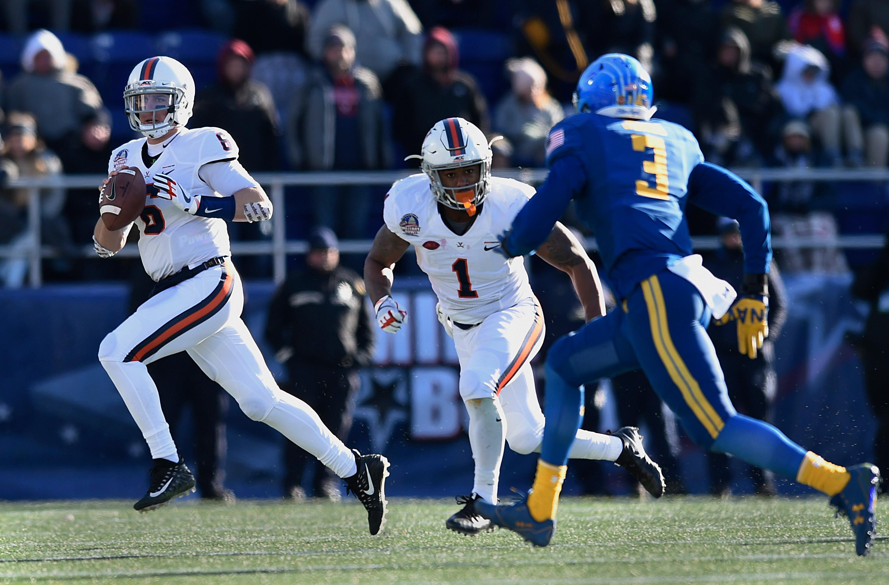 Virginia quarterback Kurt Benkert looks to pass against Navy in the first half of the Military Bowl NCAA college football game, Thursday, Dec. 28, 2017, in Annapolis, Md. (AP Photo/Gail Burton)