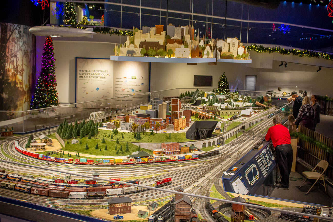 The display is one of the largest portable models in the world, consisting of over 300 rail cars, 1,000 feet of track, and 60 engines that will power the tiny trains to travel over 100,000 scale miles by the time the holiday season is over. All of the models, including the trains, tracks, and buildings, are precisely 1/48th of their actual size. / Image: Katie Robinson, Cincinnati Refined // Published: 11.8.19