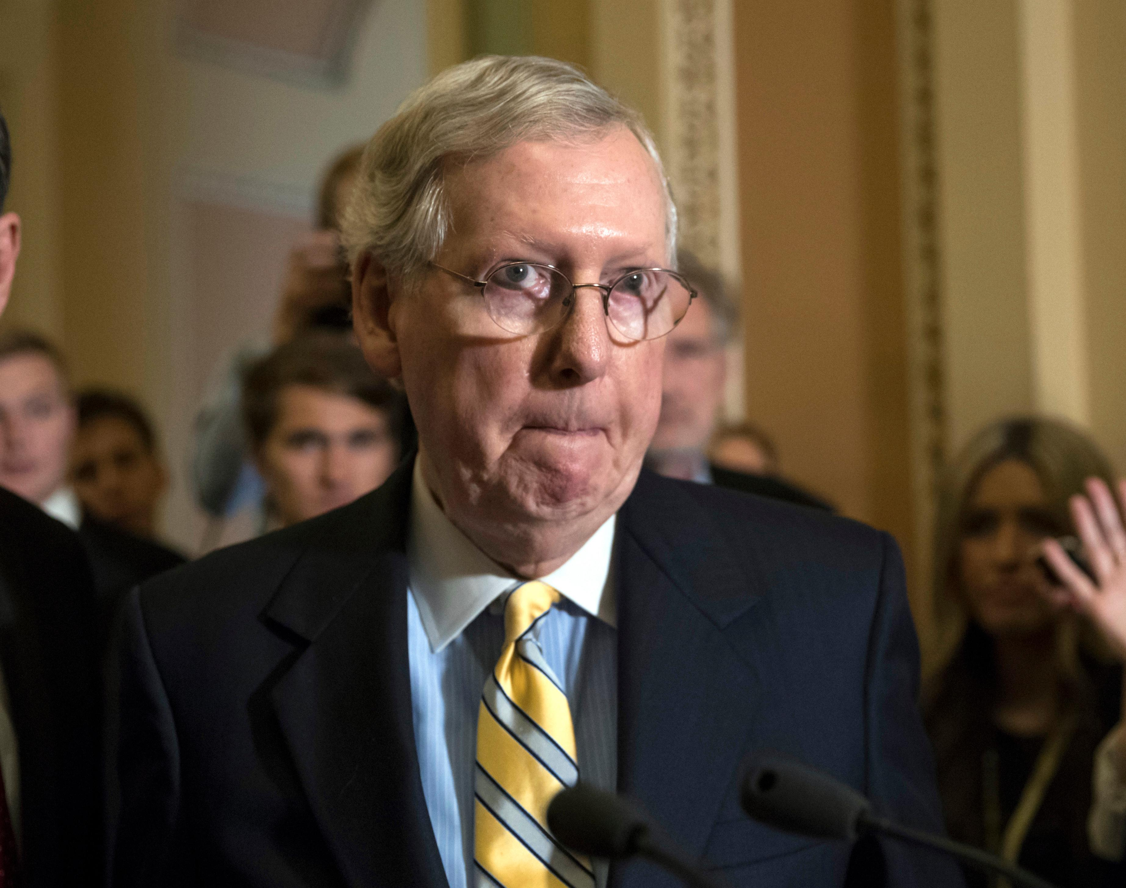 In this June 27, 2017, photo Senate Majority Leader Mitch McConnell, R-Ky., tells reporters he is delaying a vote on the Republican health care bill while GOP leadership works toward getting enough votes, at the Capitol in Washington. (AP Photo/J. Scott Applewhite)