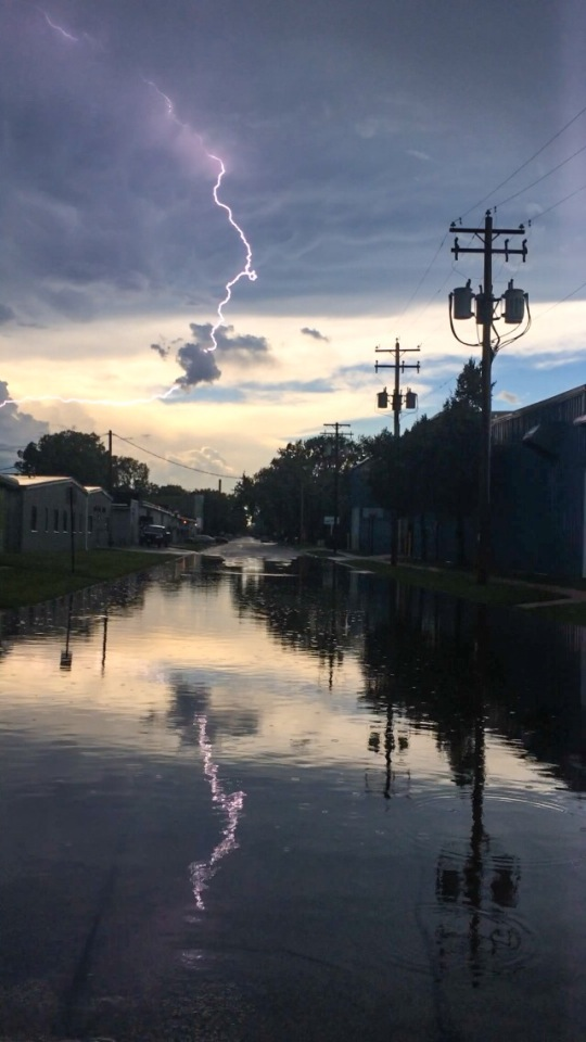 "Aug. 14: ""Post storm with flooded street on Reber St. Caught a lightening bolt in water!"" (Submitted by Kim Vorpahl)"