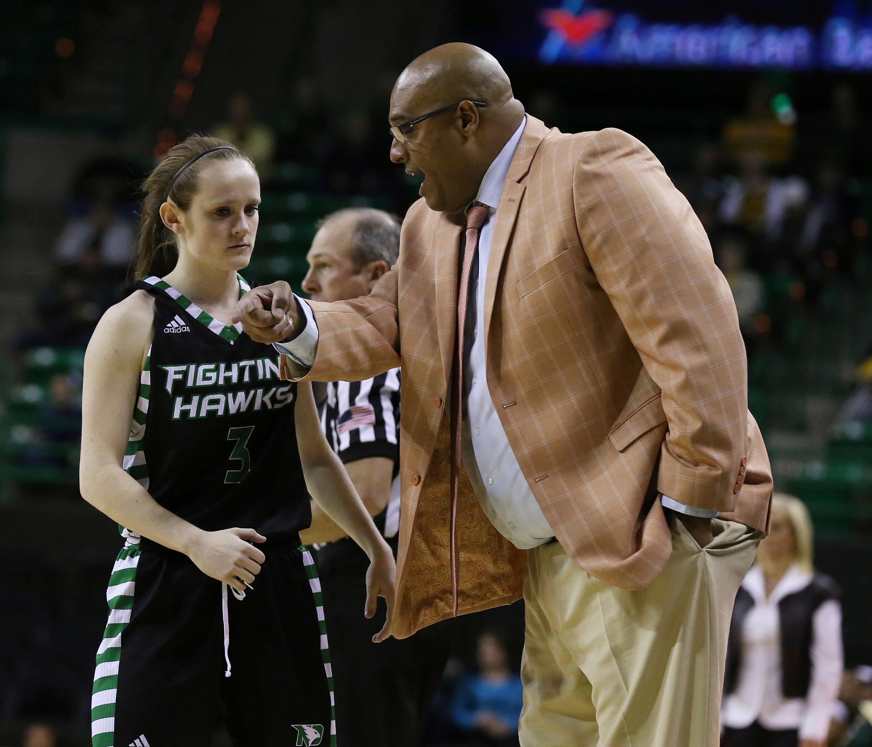 North Dakota coach Travis Brewster, right, talks with guard Melissa Dailey, left, during a timeout in the first half of an NCAA college basketball game against Baylor, Tuesday, Dec. 5, 2017, in Waco, Texas. (Rod Aydelotte/Waco Tribune Herald via AP)