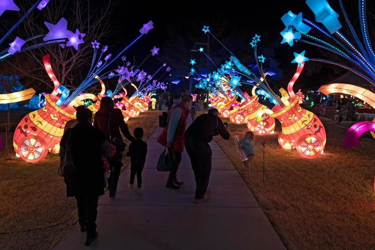 People stroll under an archway of exploding cannons on the opening night of the China Lights lantern festival Friday, January 19, 2018, at Craig Ranch Regional Park in North Las Vegas. The festival, which features nearly 50 silk and LED light displays comprised of over 1000 elements, runs through February 25th. CREDIT: Sam Morris/Las Vegas News Bureau