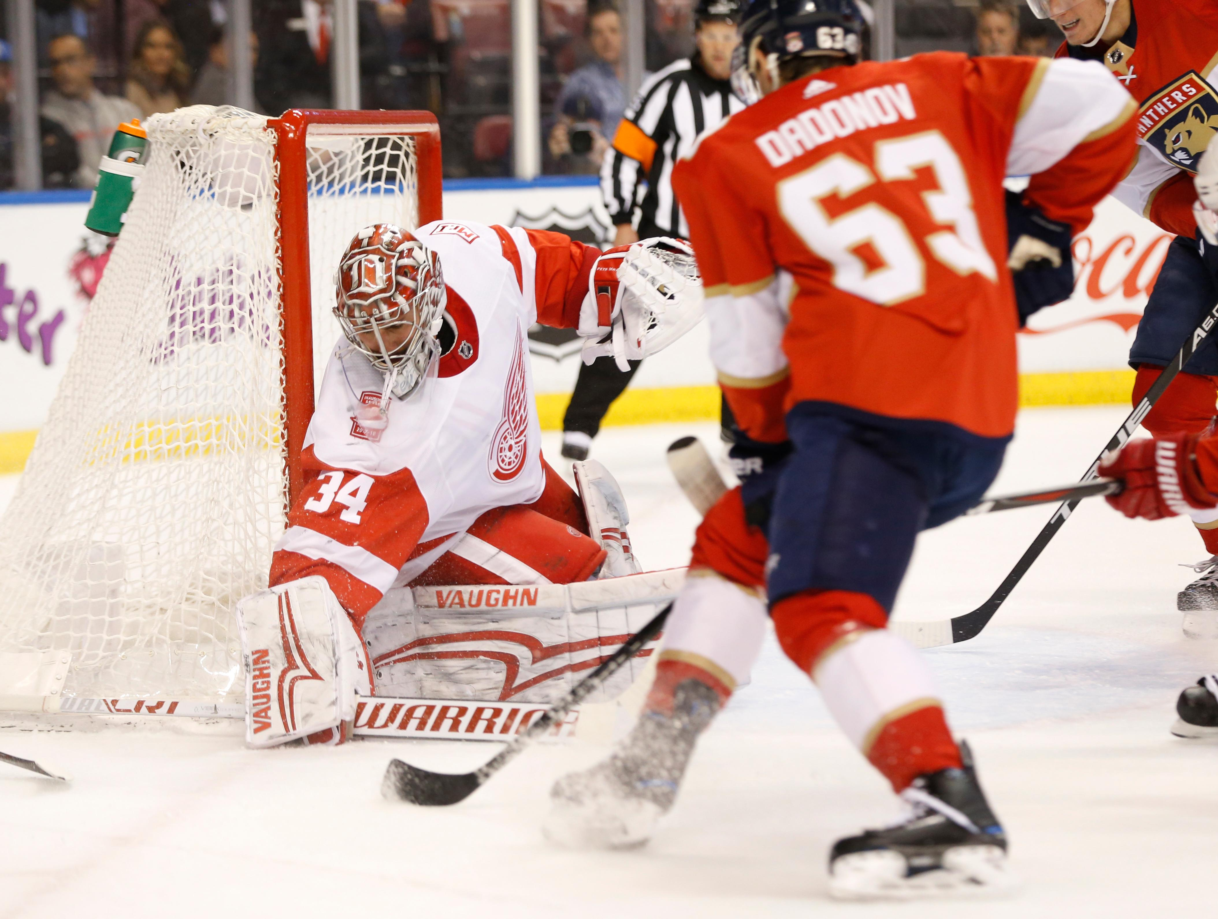 Florida Panthers right wing Evgenii Dadonov (63) attempts a shot at Detroit Red Wings goaltender Petr Mrazek (34) during the first period of an NHL hockey game, Saturday, Feb. 3, 2018 in Sunrise, Fla. (AP Photo/Wilfredo Lee)