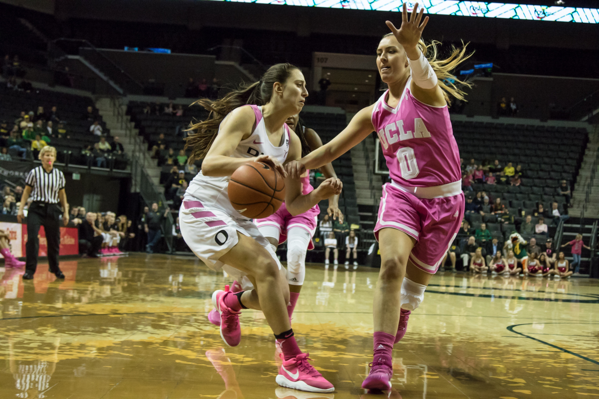 Oregon Ducks guard Maite Cazorla (#5) tries to get around UCLA Bruins guard Nicole Kornet (#0). The Oregon Ducks defeated the No. 15 UCLA Bruins 84-75 Friday evening at Matthew Knight Arena in Eugene, Oregon.  Photo by Austin Hicks, Oregon News Lab