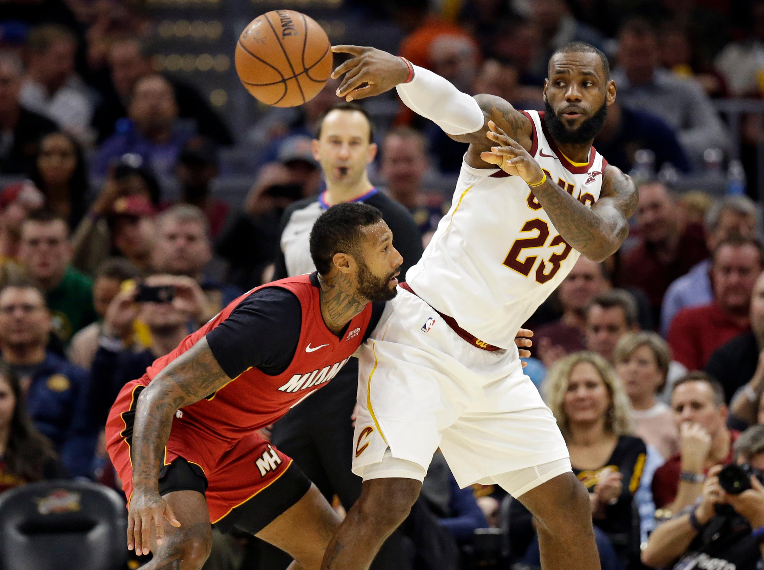 Cleveland Cavaliers' LeBron James (23) passes against Miami Heat's James Johnson (16) in the second half of an NBA basketball game, Tuesday, Nov. 28, 2017, in Cleveland. The Cavaliers won 108-97. (AP Photo/Tony Dejak)
