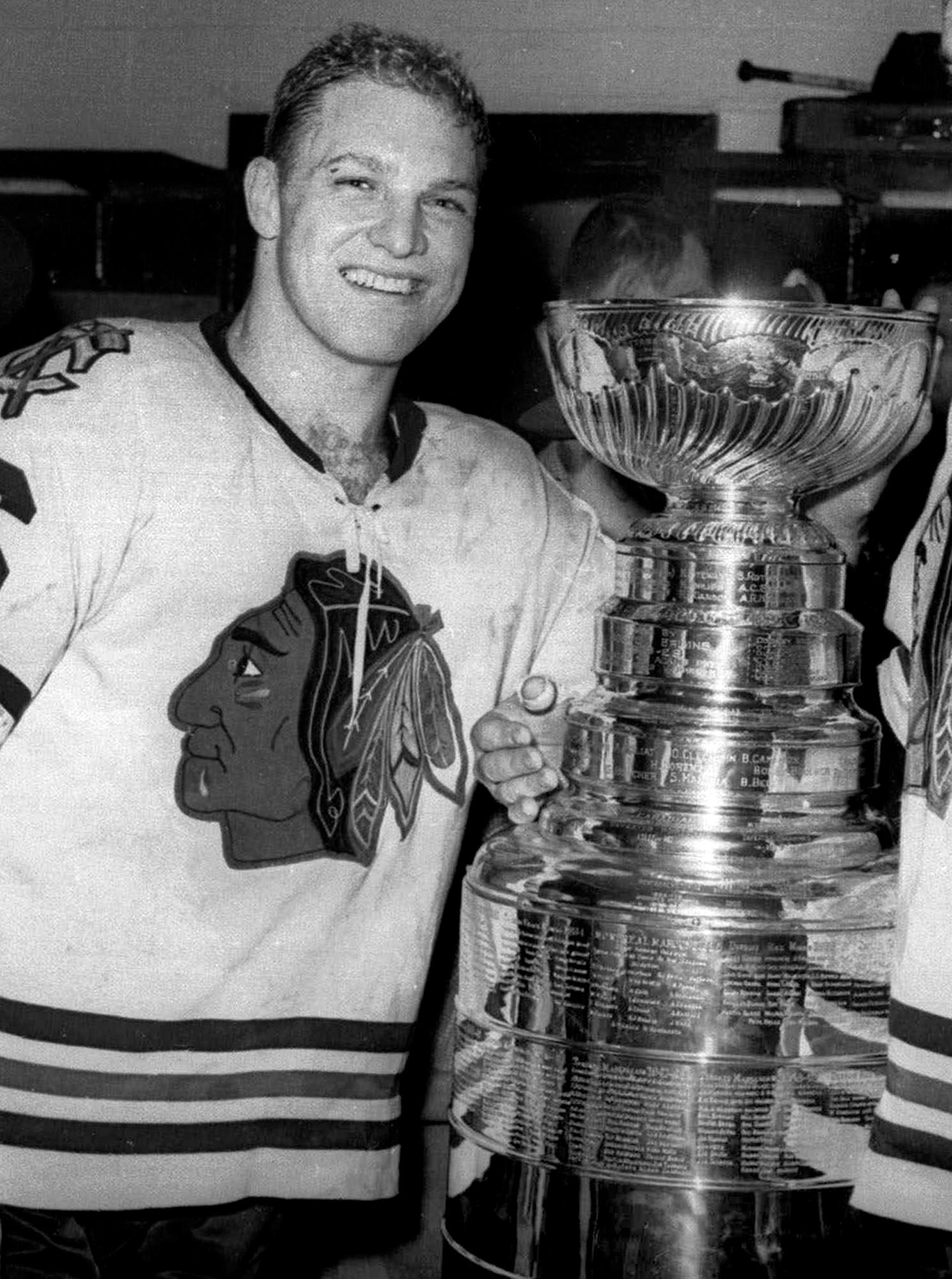 In this April 16, 1961, file photo, Chicago Blackhawks left wing Bobby Hull smiles in the dressing room after defeating the Detroit Red Wings to win the Stanley Cup in Detroit. (AP Photo)