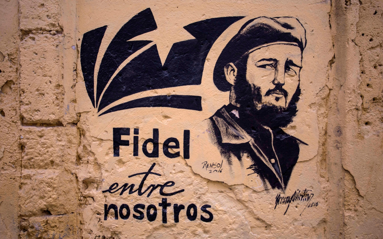"A stencil graffiti featuring Fidel Castro's image says in Spanish ""Fidel among us,"" in an alleyway in Havana, Cuba, Sunday, Nov. 27, 2016.  (AP Photo/Desmond Boylan)"