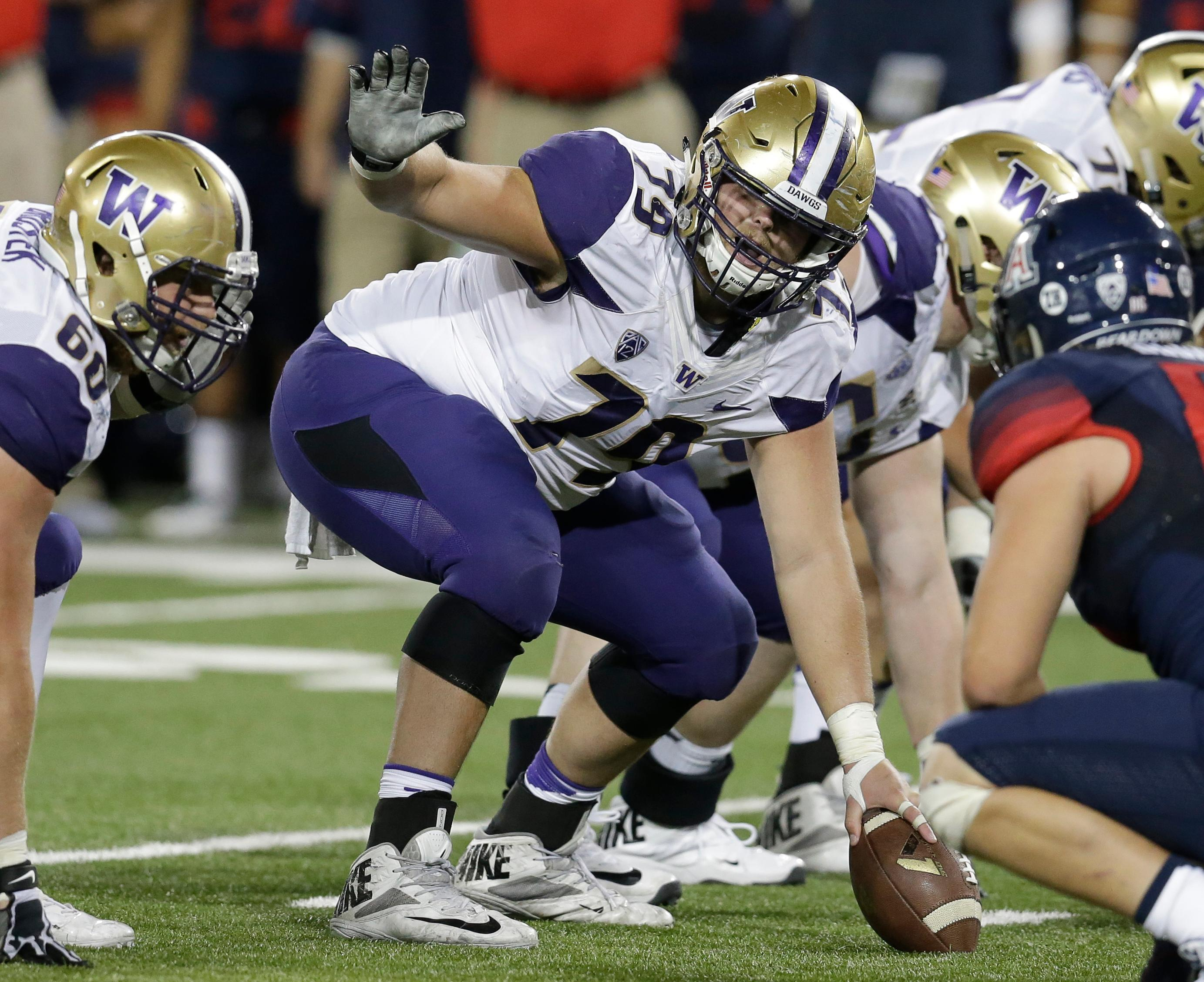 FILE - In this Sept. 24, 2016, file photo, Washington offensive center Coleman Shelton (79) gestures during the first half of an NCAA college football game against Arizona,  in Tucson, Ariz. Shelton was selected to the 2017 AP All-Conference Pac-12 team announced Thursday, Dec. 7, 2017. (AP Photo/Rick Scuteri, File)