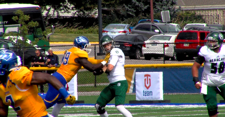 Hinwa Allieu (99), a defensive lineman at UNK, sacks Northwest Missouri quarterback Zach Martin on Sept. 16, 2017 (KHGI)