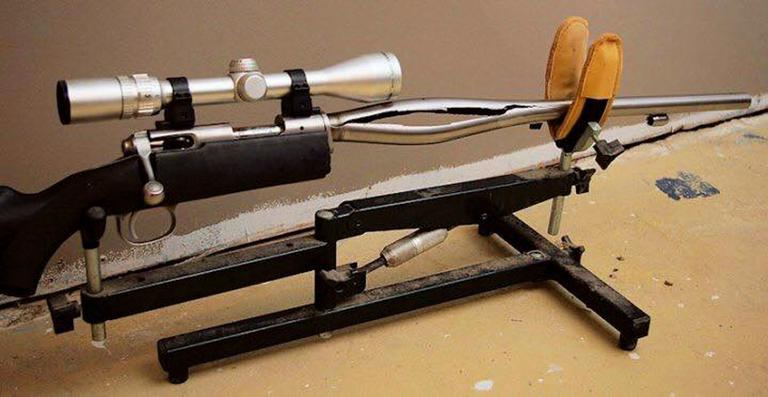 In this 2009 photo provided by Trent Procter, a Savage Arms stainless steel 10ML-II muzzleloader owned by Procter of Swan River, Manitoba, Canada, is displayed weeks after its barrel exploded and severely injured his left hand. Savage Arms recently agreed to pay a confidential settlement to Procter to resolve his lawsuit, one of several that allege the company kept a defective firearm on the market. (Gordon Harris/Trent Procter via AP)