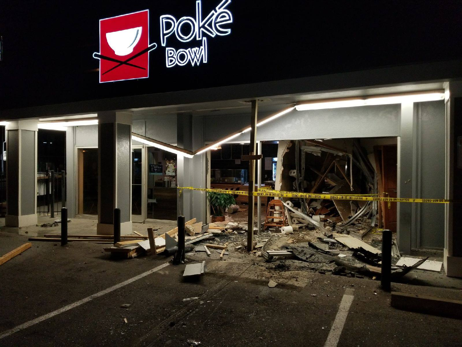 A UT student is accused of driving drunk and crashing her car into the Poke Bowl restaurant near campus. (Photo credit: Poke Bowl Team)