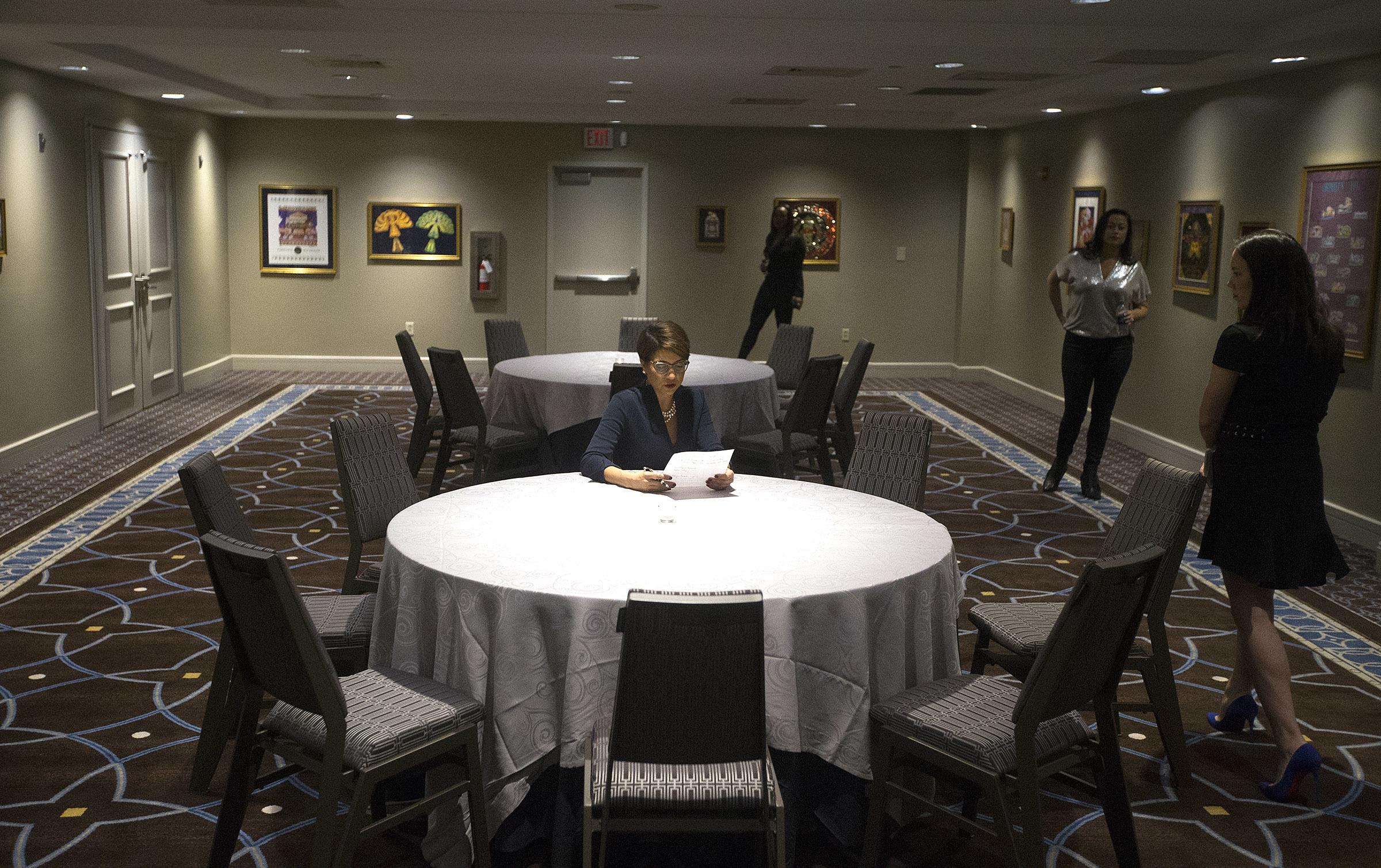 "Former municipal Judge Desiree Charbonnet looks over notes before she thanks her supporters as she concedes to LaToya Cantrell in the New Orleans mayoral race at the Sheraton Hotel in New Orleans, Saturday, Nov. 18, 2017. ""I do not regret one moment of anything about this campaign,"" Charbonnet said. The two women led a field of 18 in an October general election to win runoff spots. (David Grunfeld/NOLA.com The Times-Picayune via AP)"
