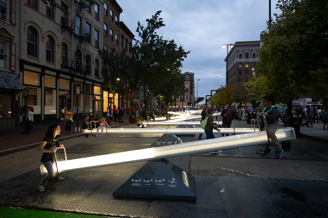 PICTURED NEIGHBORHOOD: Downtown / All of Court Street between Vine and Walnut is closed to cars and features lighted seesaws, a stage for music, and food vendors. / Image: Phil Armstrong // Published: 10.12.19