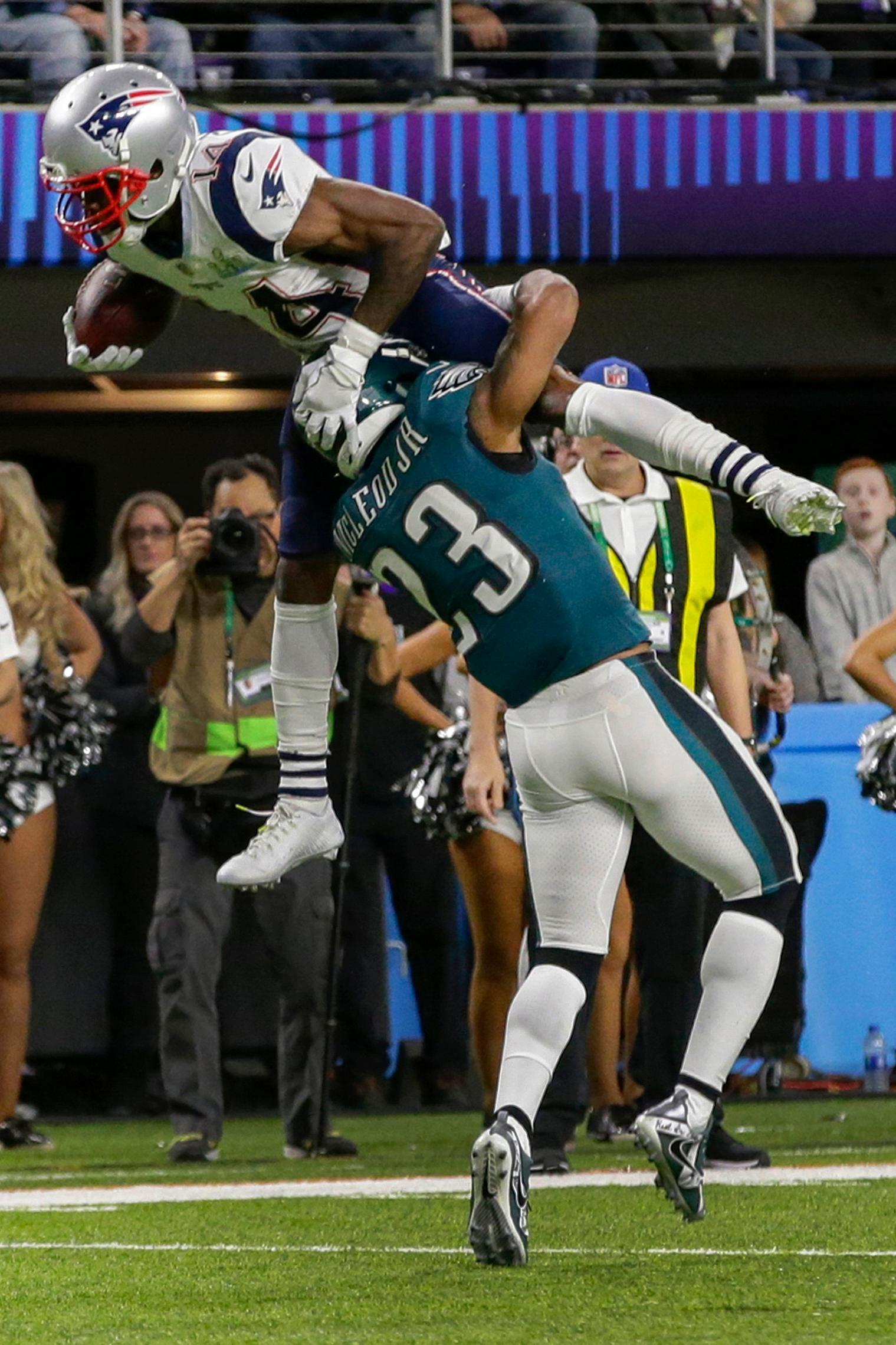 New England Patriots wide receiver Brandin Cooks (14), leaps over Philadelphia Eagles free safety Rodney McLeod (23), during the first half of the NFL Super Bowl 52 football game, Sunday, Feb. 4, 2018, in Minneapolis. (AP Photo/Frank Franklin II)