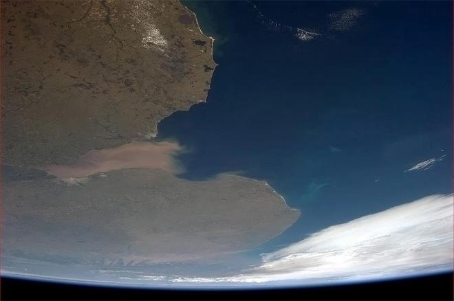 Today's photo is of Argentina. A tongue of mud lashing in the river's mouth. (Photo & Caption: Col. Chris Hadfield, NASA)