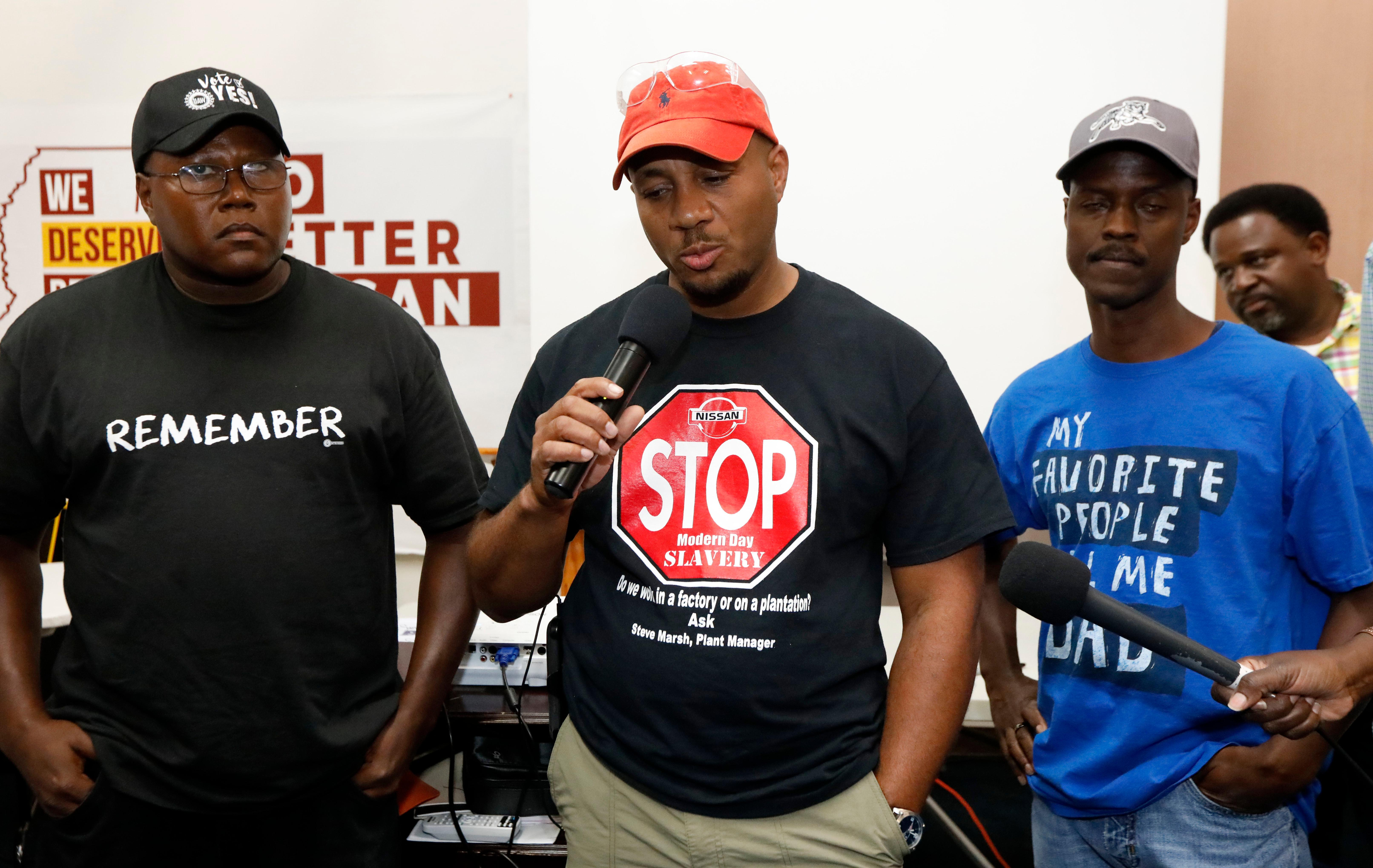 Nissan employee Morris Mock, center, flanked by other Nissan employees expresses his disappointment at losing their bid to have union representation at the Nissan vehicle assembly plant in Canton, Miss., Friday, Aug. 4, 2017. (AP Photo/Rogelio V. Solis)