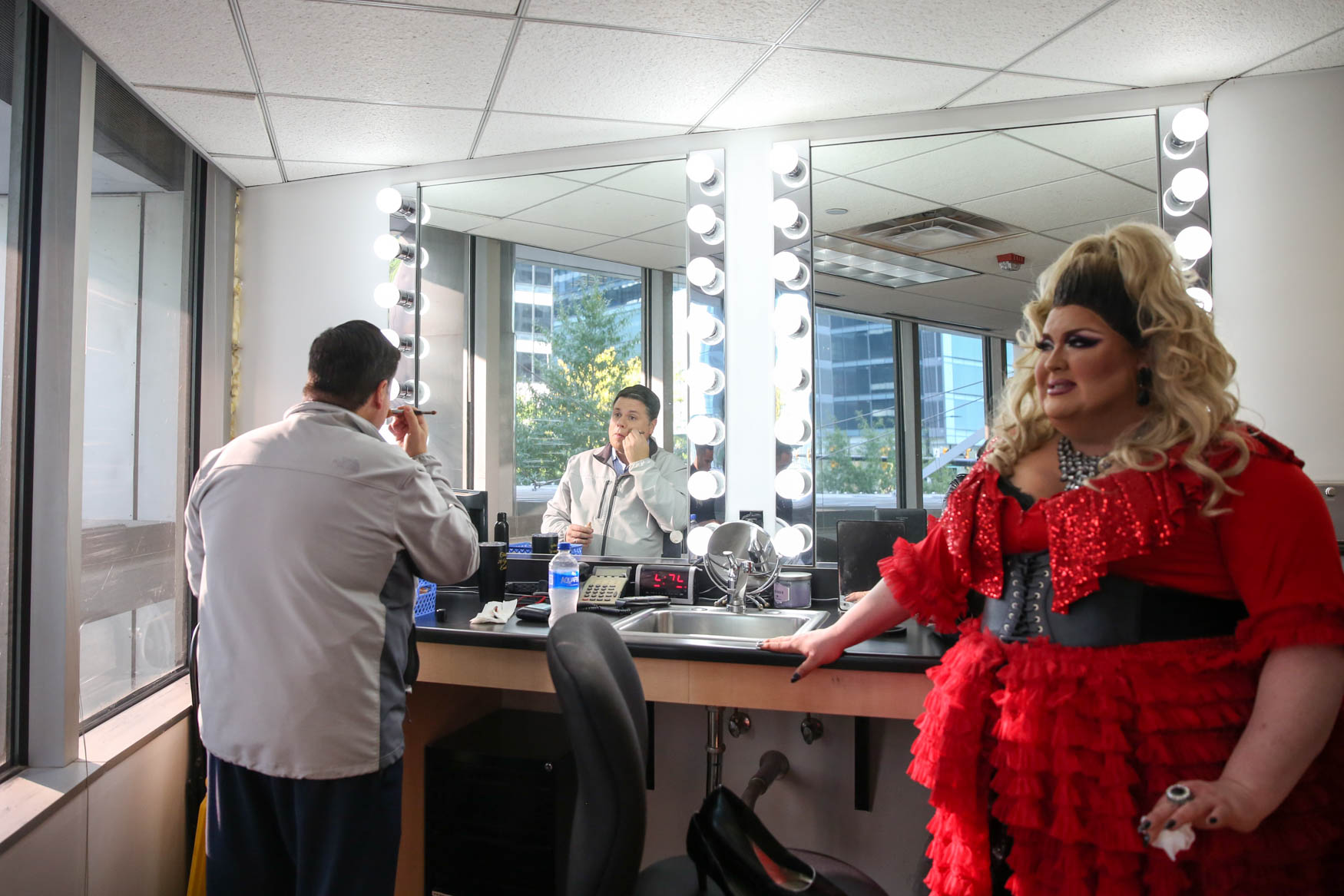 Local drag queen{ }Ba 'Naka watches as{ }Meteorologist Brian van de Graaff puts on his makeup before they both make a guest appearance on Good Morning Washington. Every on-air talent applies makeup before getting in front of the camera.{ }(Amanda Andrade-Rhaodes/DC Refined)