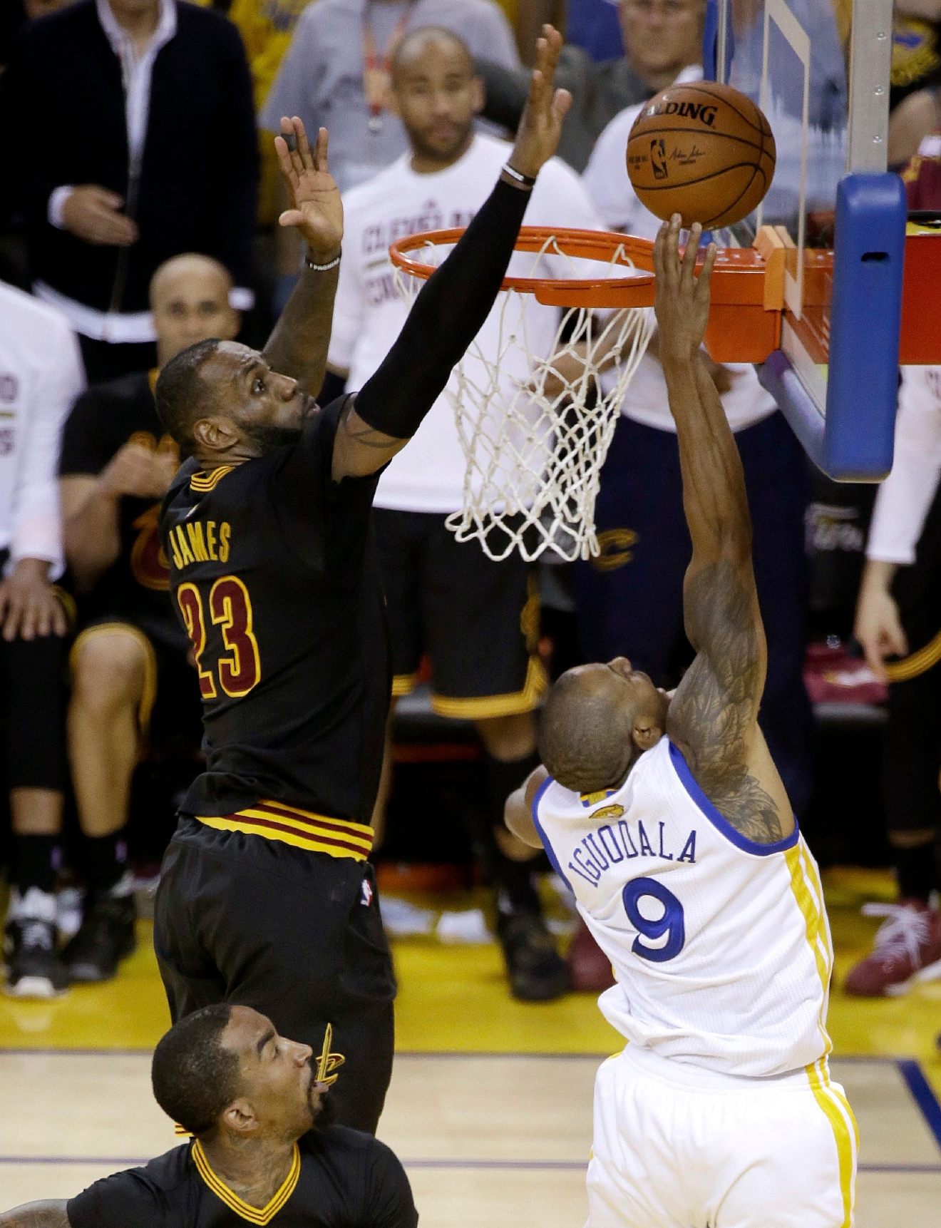 In this Sunday, June 19, 2016 photo, Cleveland Cavaliers forward LeBron James (23) blocks a shot by Golden State Warriors forward Andre Iguodala (9) during the second half of Game 7 of basketball's NBA Finals in Oakland, Calif. James had three blocked shots, including this key one against Iguodala on a fast break in the final minutes. The Cavaliers won 93-89. (AP Photo/Eric Risberg)