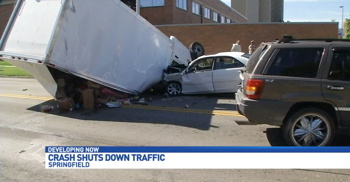 A truck carrying soda has flipped in downtown Springfield at the intersection of East Carpenter Street & North 4th Street. (WICS)