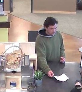 Image of Christopher J. Becker from the credit union he reportedly robbed on Jan. 22, 2018. (Photo via Corvallis Police Department)<p></p>