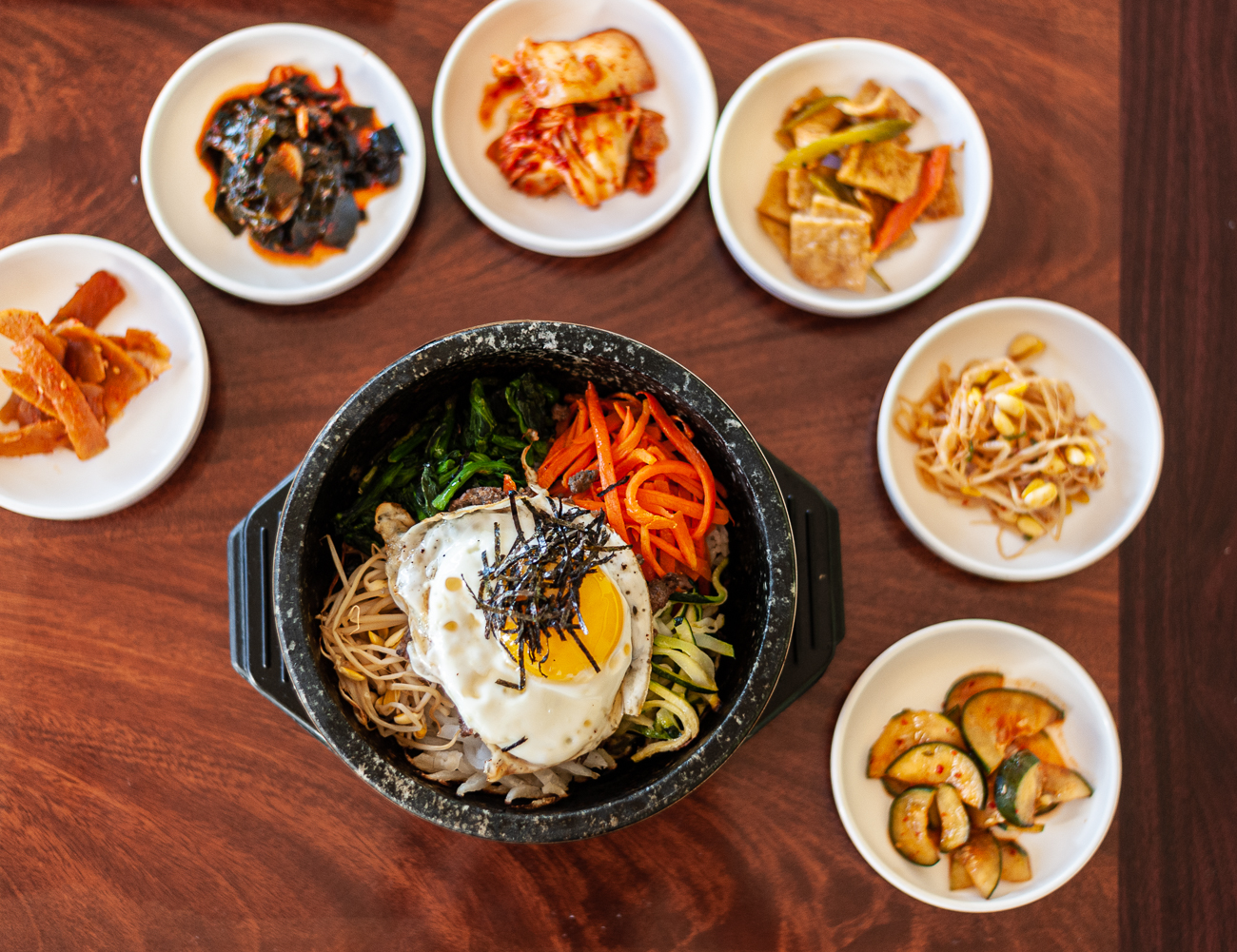 Dolsot Bibimbap with starters / Image: Kellie Coleman // Published: 12.29.20<p></p>