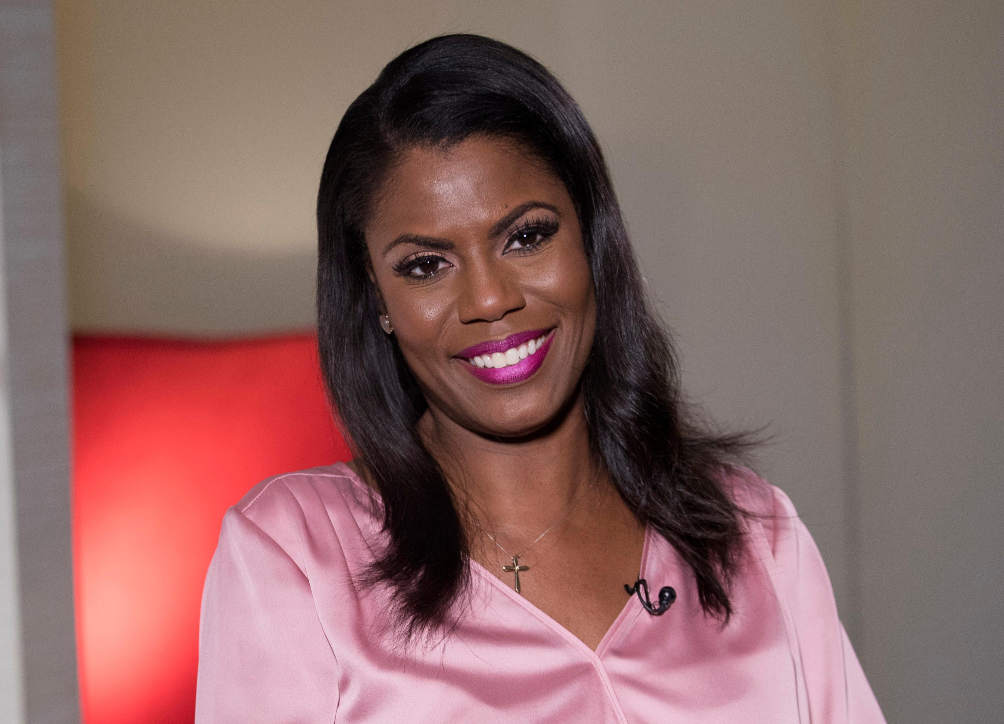 "FILE - In this Aug. 14, 2018, file photo former White House staffer Omarosa Manigault Newman smiles during an interview in New York.  Manigault Newman's ""Unhinged"" sold 34,000 copies, NPD BookScan reported Thursday, Aug. 23. BookScan tracks around 85 percent of the print market. (AP Photo/Mary Altaffer, File)"