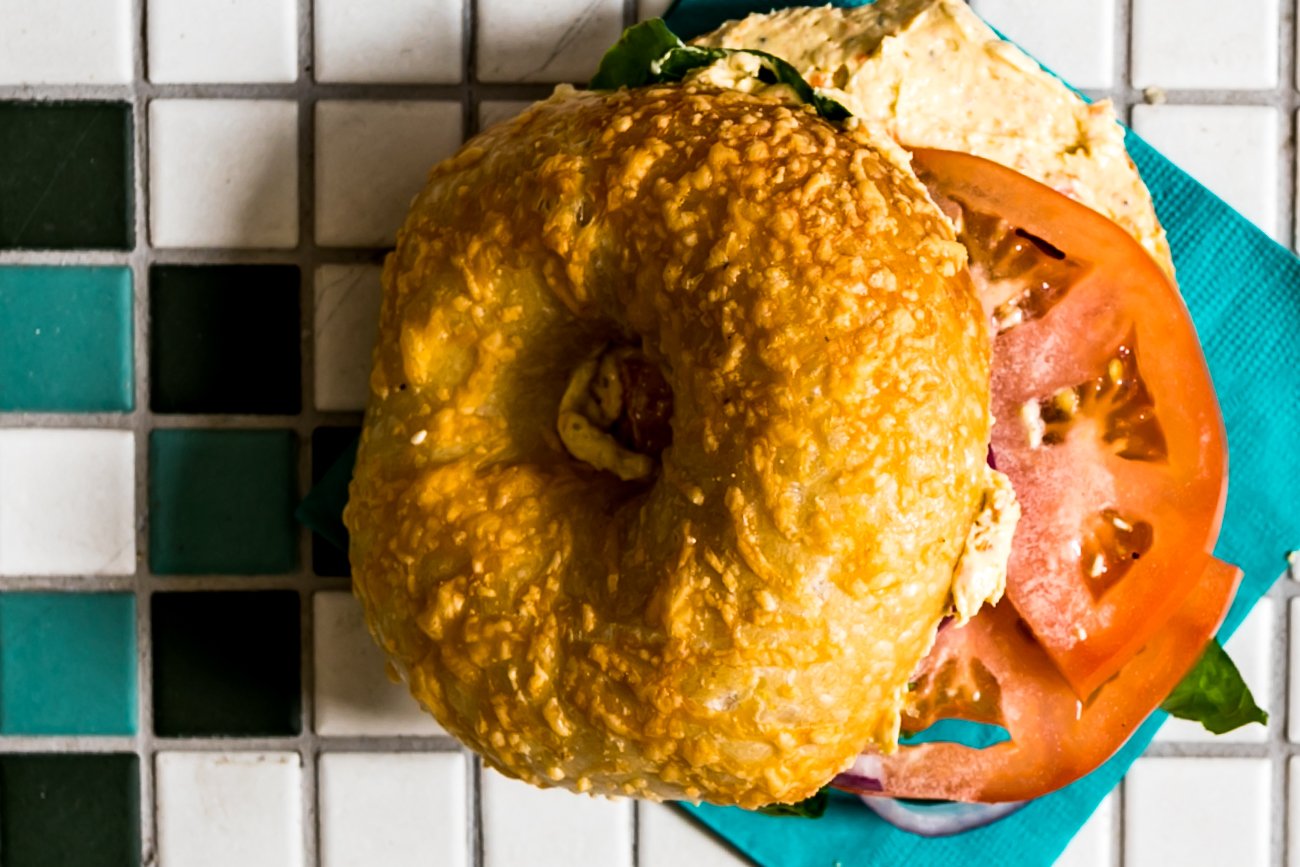 Asiago bagel with vegan veggie cream cheese, tomato, lettuce, and red onion / Image: Amy Elisabeth Spasoff // Published: 10.5.18