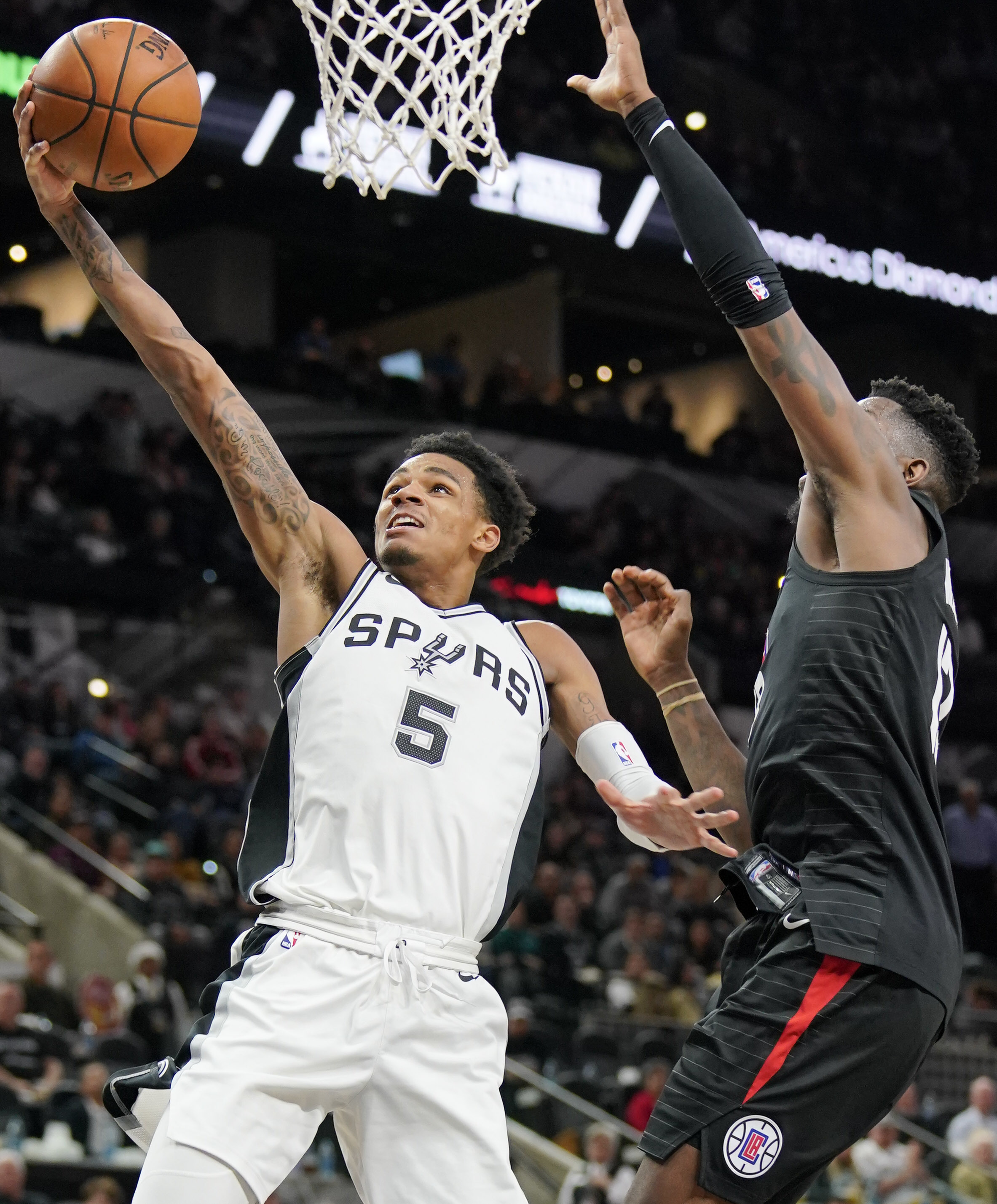 Dejounte Murray drives against Jamil Wilson. (AP Photo/Darren Abate)